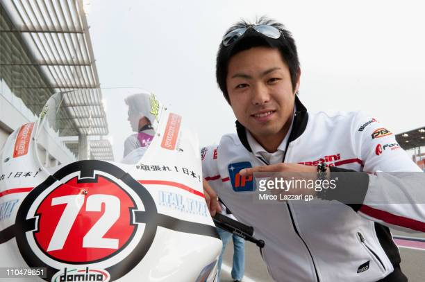 Yuki Takahashi of Japan and Gresini Racing Moto2 supports the Japan people before the qualifying practice at Losail Circuit on March 19, 2011 in...