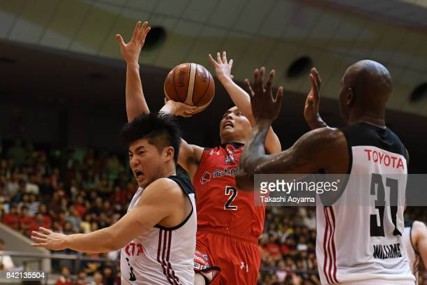 Yuki Togashi of the Chiba Jets shoots while under pressure from Seiya Ando and Jawad Williams of the Alvark Tokyo during the B.League Kanto Early Cup...