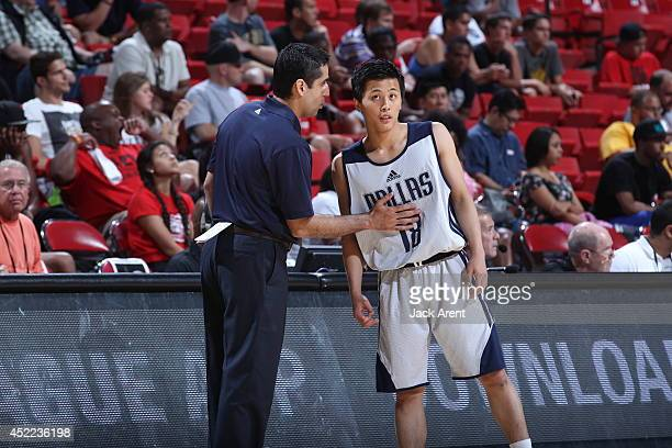 Yuki Togashi of the Dallas Mavericks talks with Head Coach Kaleb Canales during the game against the Charlotte Hornets at the Samsung NBA Summer...