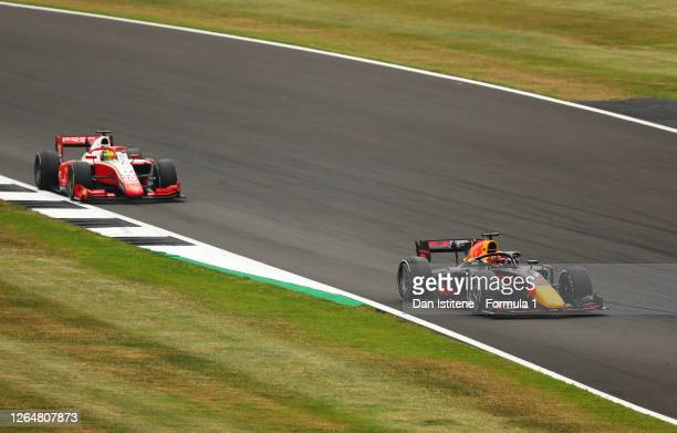 Yuki Tsunoda of Japan and Carlin leads Mick Schumacher of Germany and Prema Racing during the sprint race of the Formula 2 Championship at...