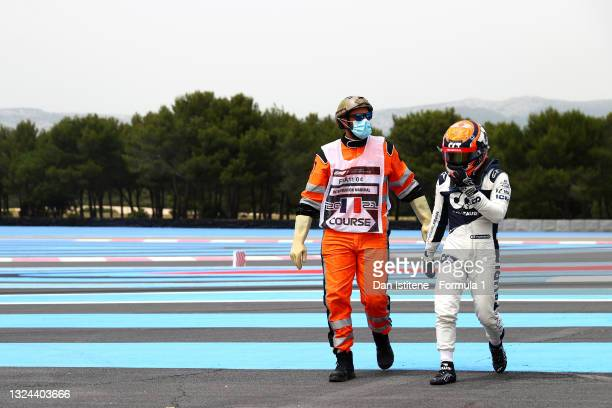 Yuki Tsunoda of Japan and Scuderia AlphaTauri walks off the circuit after spinning during qualifying ahead of the F1 Grand Prix of France at Circuit...
