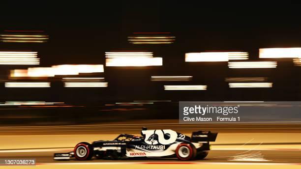 Yuki Tsunoda of Japan driving the Scuderia AlphaTauri AT02 Honda during Day Three of F1 Testing at Bahrain International Circuit on March 14, 2021 in...