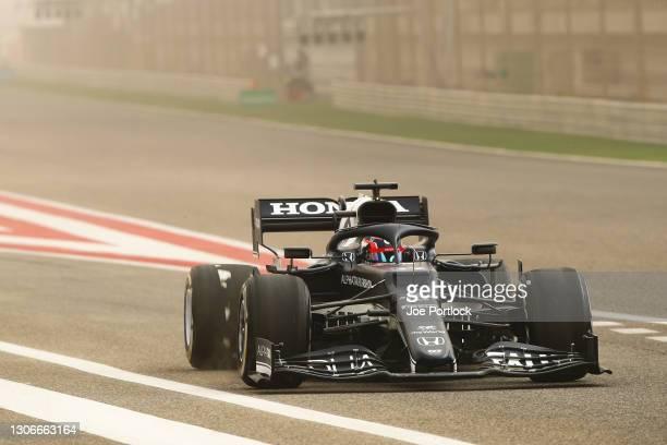 Yuki Tsunoda of Japan driving the Scuderia AlphaTauri AT02 Honda leaves the pitlane during Day One of F1 Testing at Bahrain International Circuit on...