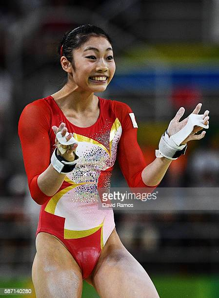 Yuki Uchiyama of Japan reacts after competing on the uneven bars during Women's qualification for Artistic Gymnastics on Day 2 of the Rio 2016...