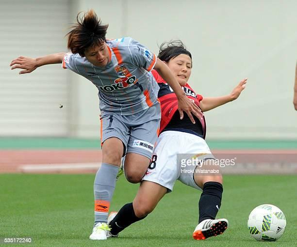 Yuki Yajima of AC Nagano Parceiro is tackled by Hikaru Naomoto of Urawa Reds Ladies during the Nadeshiko League match between Urawa Red Diamonds...