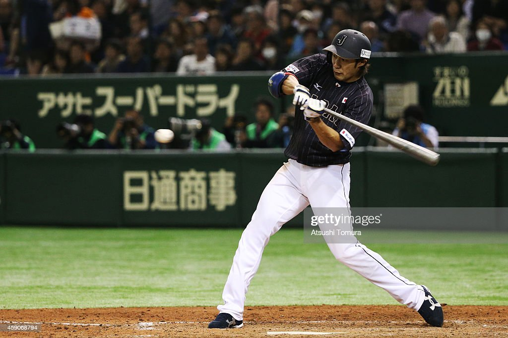 Yuki Yanagita #44 of Samurai Japan hits a single in the eighth inning during the game four of Samurai Japan and MLB All Stars at Tokyo Dome on November 16, 2014 in Tokyo, Japan.