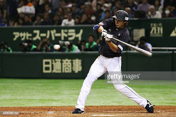 Yuki Yanagita of Samurai Japan hits a single in the eighth inning during the game four of Samurai Japan and MLB All Stars at Tokyo Dome on November...