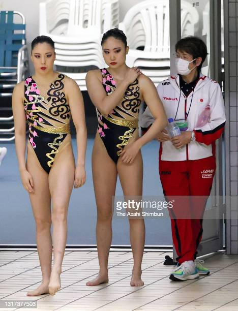 Yukiko Inui and Megumu Yoshida are seen with Japan national team head coach Masayo Imura before the Duet Technical Routine on day two of the Artistic...