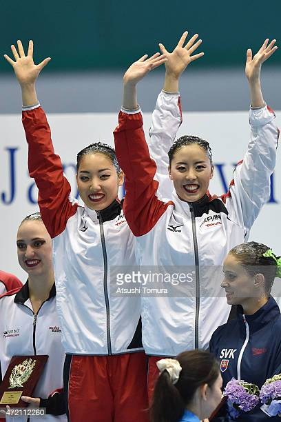 Yukiko Inui and Risako Mitsui of Japan celebrate on the podium after the duet free routine final during day three of the Synchro Japan Open 2015 at...