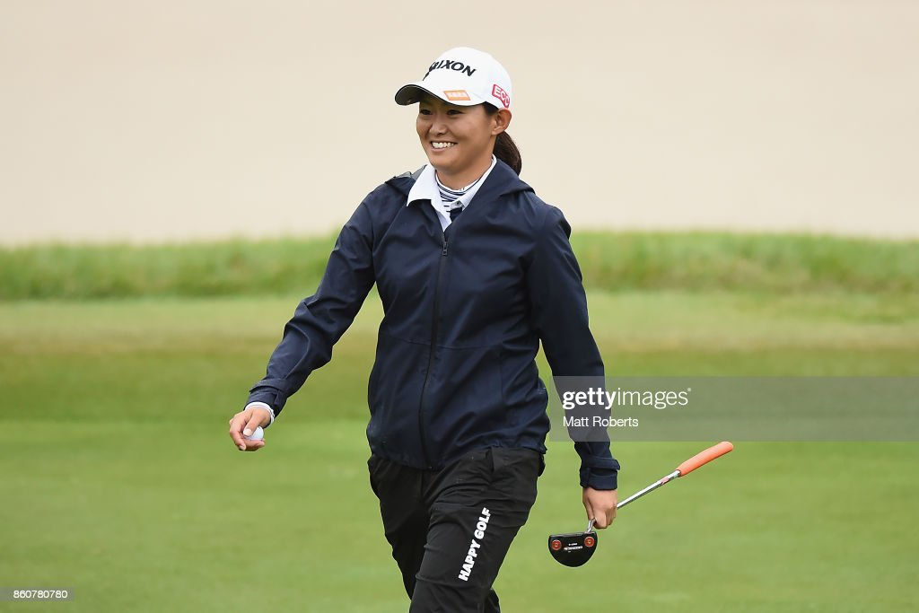 Yukiko Nishiki of Japan smiles after her putt on the 2nd green during the first round of the Fujitsu Ladies 2017 at the Tokyu Seven Hundred Club on October 13, 2017 in Chiba, Japan.