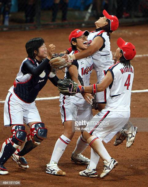 Yukiko Ueno and Japanese players celebrate winning the gold medal after the women's grand final gold medal softball game between Japan and United...