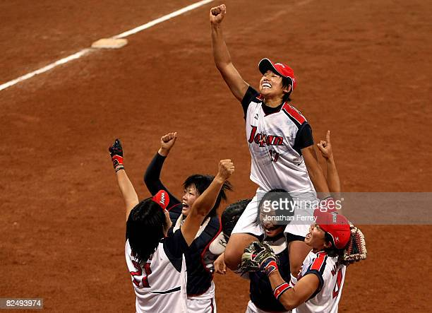 Yukiko Ueno of Japan and her teammates celebrate Japan's 3-1 win against the United States during the women's grand final gold medal softball game at...