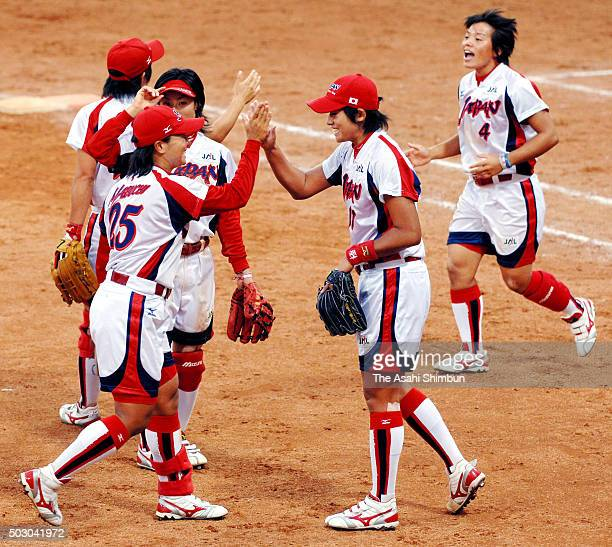 Yukiko Ueno of Japan celebrates her team's 10 win with her team mates after the Softball Women's World Championship PlayOff match between Japan and...