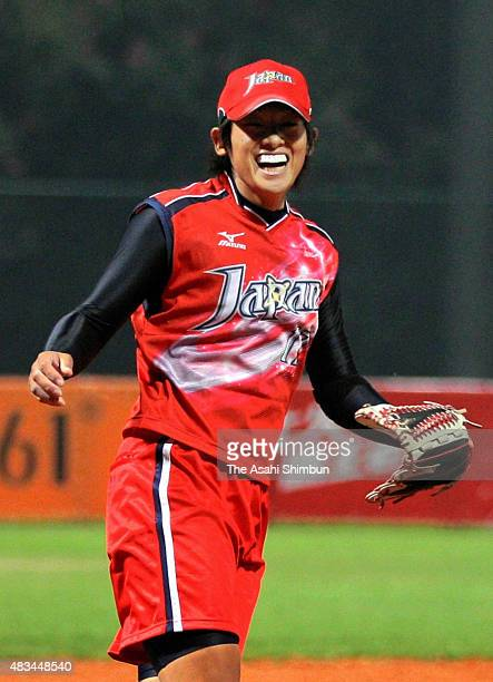 Yukiko Ueno of Japan celebrates winning the gold in the Softball Grand Final match between China and Japan in day fourteen of the Guangzhou Asian...
