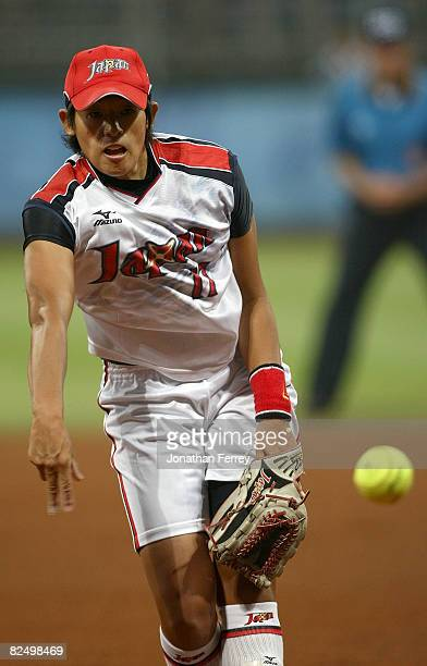 Yukiko Ueno of Japan delivers a pitch against the United States during the women's grand final gold medal softball game at the Fengtai Softball Field...
