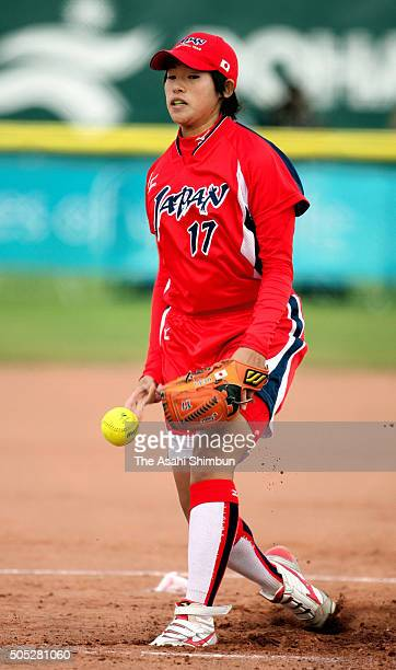 Yukiko Ueno of Japan delivers a pitch in the Softball Grand Final match between Japan and China during day thirteen of the 15th Asian Games at the...