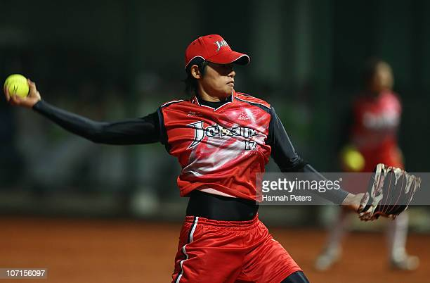 Yukiko Ueno of Japan pitches during the final match between China and Japan at Tianhe Softball Field during day fourteen of the 16th Asian Games...