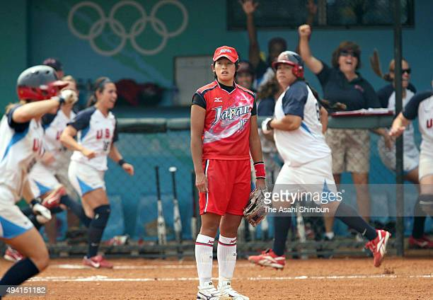 Yukiko Ueno of Japan reacts after a three run homer by Crystl Bustos of the United States in the ninth inning during the women's semifinal softball...