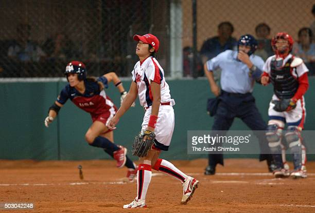 Yukiko Ueno of Japan reacts after allowing a home run in the top of sixth inning during the Softball Women's World Championship Final between the...