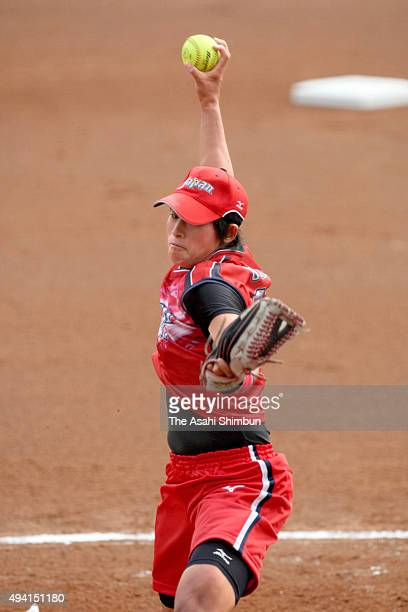 Yukiko Ueno of Japan throws a pitch against the United States in a women's semifinal softball game at the Fengtai Softball Field during day twelve of...