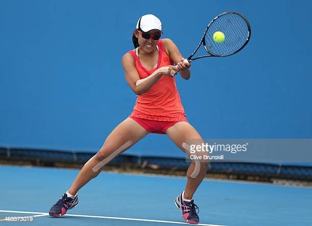 Yukina Saigo of Japan plays a backhand in her first round junior girls' match against Anja Dokic of Australia during day six of the 2014 Australian...