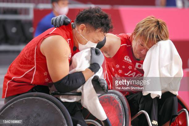 Yukinobu Ike and Daisuke Ikezaki of Team Japan show dejection after their defeat in the Wheelchair Rugby semifinal between Japan and Great Britain on...