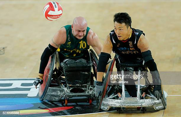 Yukinobu Ike of Japan chaes a long ball with Aussie Chris Bond during a match in the World Wheelchair rugby challenge at the Copper Box Arena Queen...