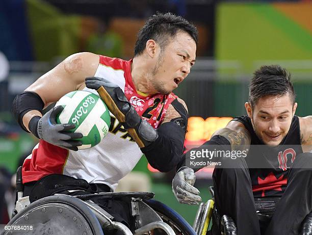Yukinobu Ike of Japan keeps the ball from Canada's Trevor Hirschfield during the men's wheelchair rugby bronze medal match at the Rio de Janeiro...