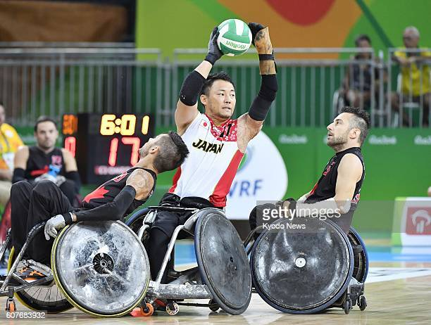 Yukinobu Ike of Japan passes the ball during the men's wheelchair rugby bronze medal match against Canada at the Rio de Janeiro Paralympics on Sept...