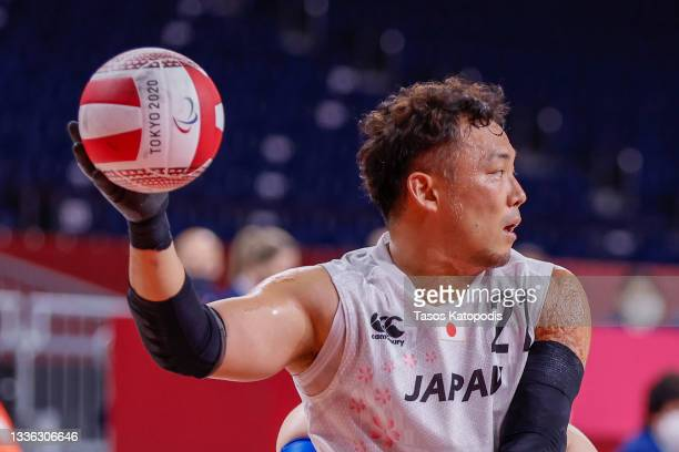 Yukinobu Ike of team Japan passes the ball against team France during their Group A wheelchair rugby match four on day 1 of the Tokyo 2020 Paralympic...