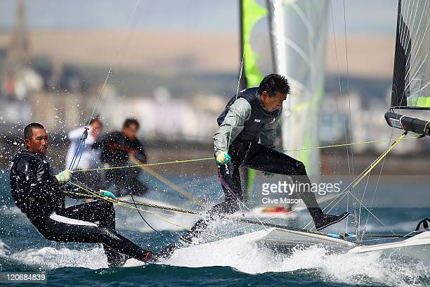Yukio Makino and Kenji Takahashi of Japan in action during a 49er Class race during day seven of the Weymouth and Portland International Regatta at...