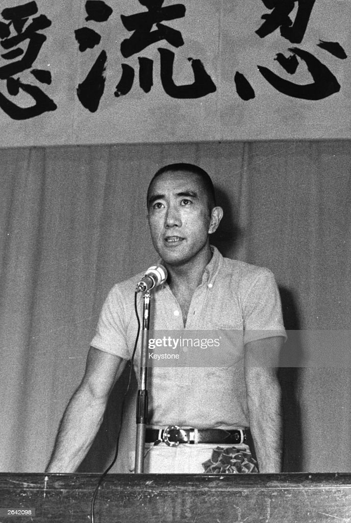 Yukio Mishima (1925 - 1970), Japanese writer, novelist and essayist, addressing the 32nd Infantry Regiment. Shortly afterwards he committed suicide in the traditional Japanese way of 'hara-kiri'.