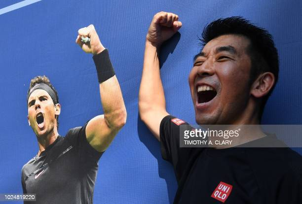 TOPSHOT Yukio Watanabe poses with a picture of Rafael Nadal during the 2018 US Open at the USTA Billie Jean King National Tennis Center in New York...
