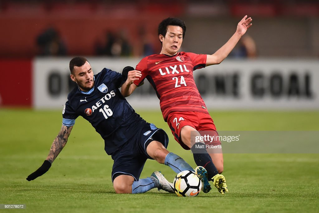 Yukitoshi Ito #24 of Kashima Antlers competes for the ball against Anthony Kalik #16 of Sydney FC during the AFC Champions League Group H match between Kashima Antlers and Sydney FC at Kashima Soccer Stadium on March 13, 2018 in Kashima, Ibaraki, Japan.