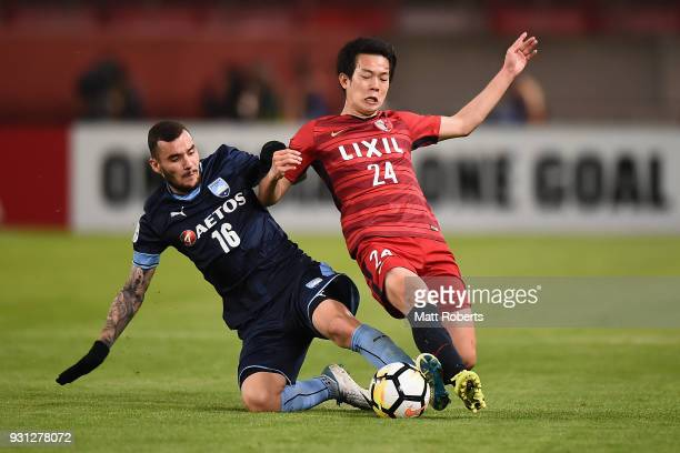 Yukitoshi Ito of Kashima Antlers competes for the ball against Anthony Kalik of Sydney FC during the AFC Champions League Group H match between...