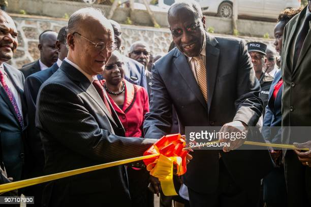 Yukiya Amano , Director General of the International Atomic Energy Agency and Prime Minister of Uganda Ruhakana Rugunda cut the tape during the...