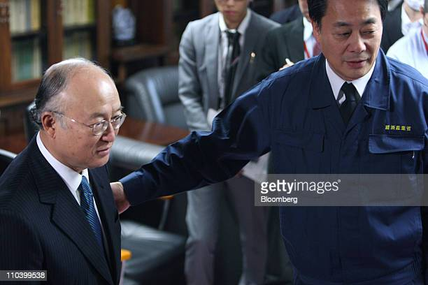 Yukiya Amano, director general of the International Atomic Energy Agency, is welcomed by Banri Kaieda, Japan's newly named economy, trade and...