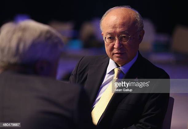Yukiya Amano, Director General of the International Atomic Energy Agency , chats with colleagues following the closing session of the 2014 Nuclear...