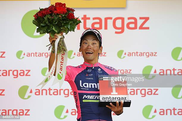 Yukiya Arashiro of Japan riding for Lampre-Merida takes the podium after being named the most aggressive rider following stage six of the 2016 Le...