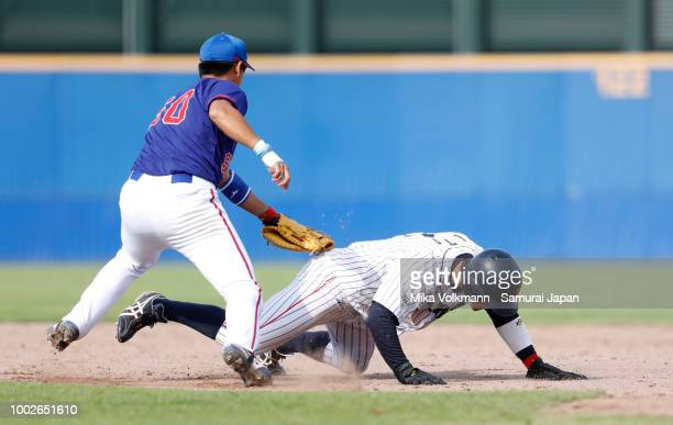 Yukiya Ito of Japan is tagged out in the 9th inning during the Haarlem Baseball Week game between Japan and Chinese Taipei at Pim Mulier Stadion on...