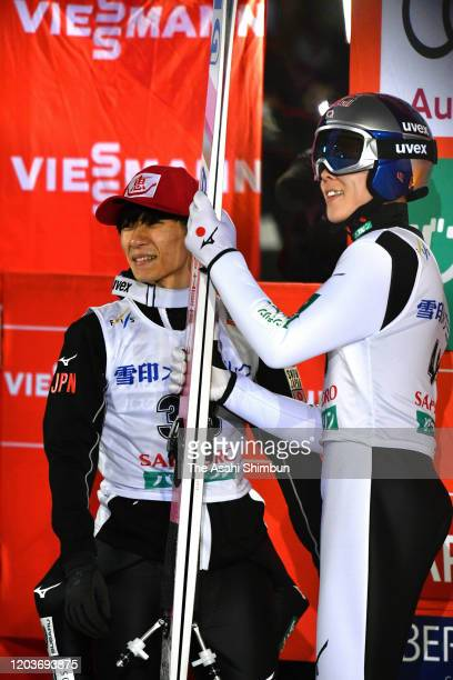 Yukiya Sato and Ryoyu Kobayashi of Japan talk after competing on day one of the FIS Ski Jumping World Cup Sapporo at Okurayama Jump Stadium on...