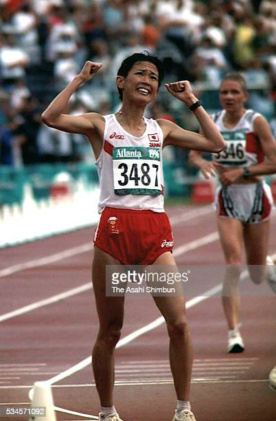 Yuko Arimori of Japan celebrates winning the bronze in the Women's marathon during the Atlanta Summer Olympic Games at the Centennial Olympic Stadium...