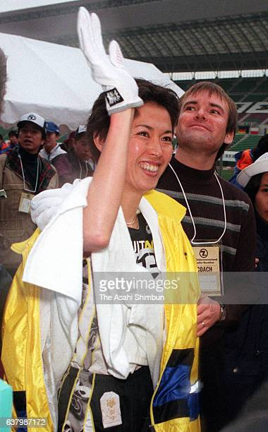Yuko Arimori of Japan waves to fans after the 19th Osaka International Ladies Marathon at the Nagai Stadium on January 30 2000 in Osaka Japan