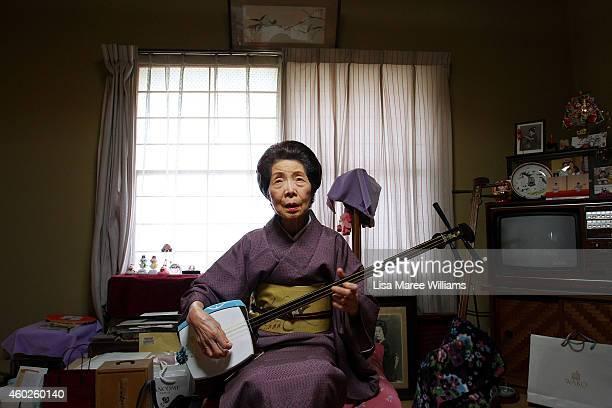 Yuko Asakusa plays the shamisen at her home studio in the Asakusa District on November 6 2014 in Tokyo Japan 91 year old Yuko Asakusa became a Geisha...