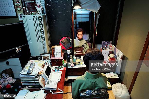 Yuko Asakusa sits at her makeup mirror at her home studio in the Asakusa District on November 6 2014 in Tokyo Japan 91 year old Yuko Asakusa became a...