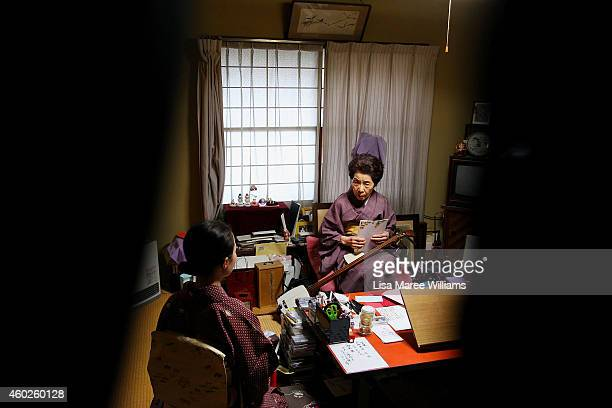Yuko Asakusa speaks with a client at her home studio in the Asakusa District on November 6 2014 in Tokyo Japan 91 year old Yuko Asakusa became a...