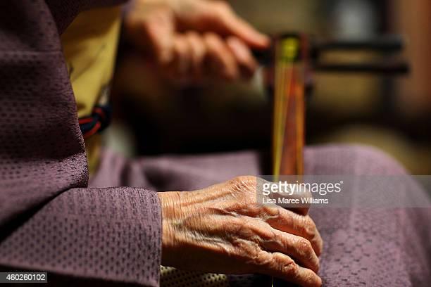 Yuko Asakusa tunes a shamisen at her home studio in the Asakusa District on November 6 2014 in Tokyo Japan 91 year old Yuko Asakusa became a Geisha...