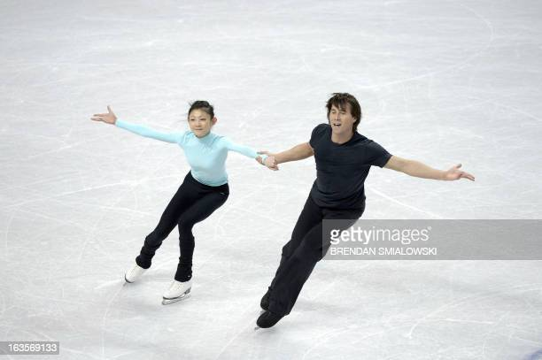 Yuko Kavaguti and Alexander Smirnov of Russia practice at Budweiser Gardens in preparation for the 2013 World Figure Skating Championships in London,...