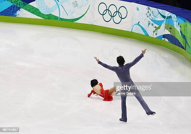 Yuko Kavaguti of Russia falls to the ice while performing a stunt with partner Alexander Smirnov in the Figure Skating Pairs Free Program on day 4 of...