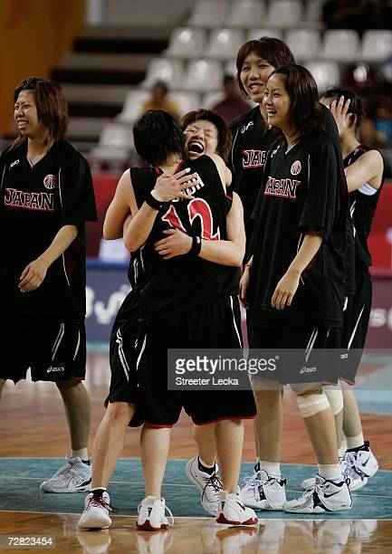 Yuko Oga and Asami Yoshida of Japan celebrate their 74 70 win over the Republic of Korea in the Women's Basketball Bronze Medal Match during the 15th...